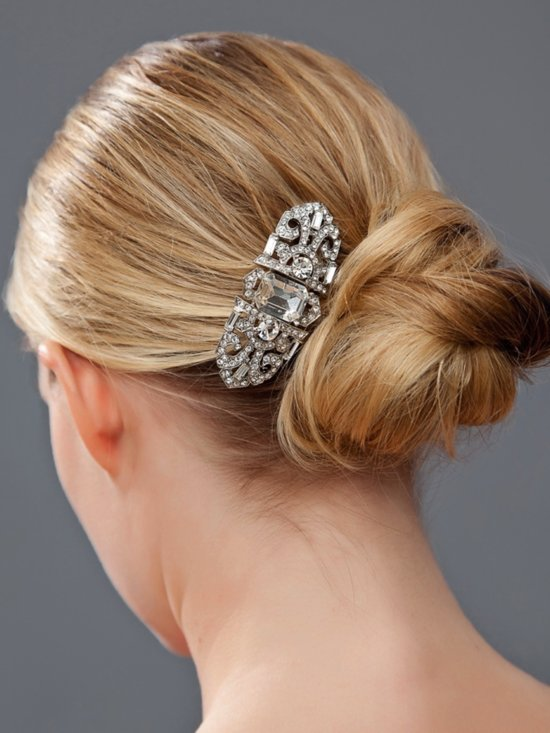 Classic bridal chignon wedding hairstyle with vintage-inspired bridal barrette