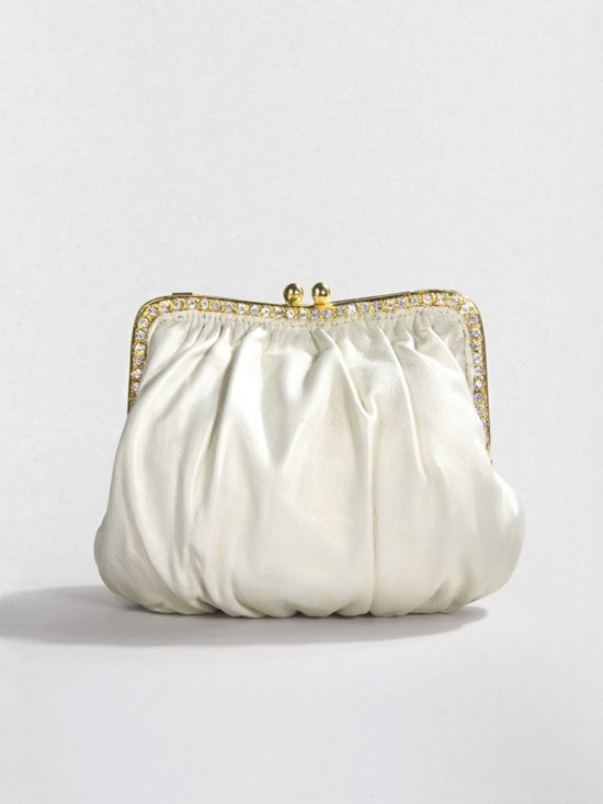 photo of Luxe bridal clutch by Clara Kasavina- Ivory Ginger Pouch via The Aisle New York