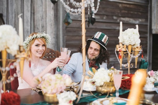Alice in Wonderland Bride and Groom at Table