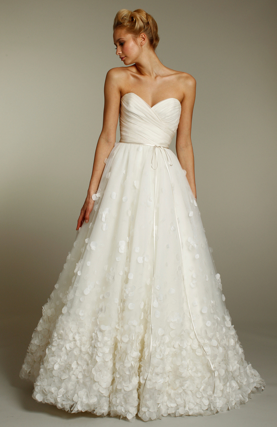 Ivory a-line wedding dress with sweetheart neckline and embellished skirt