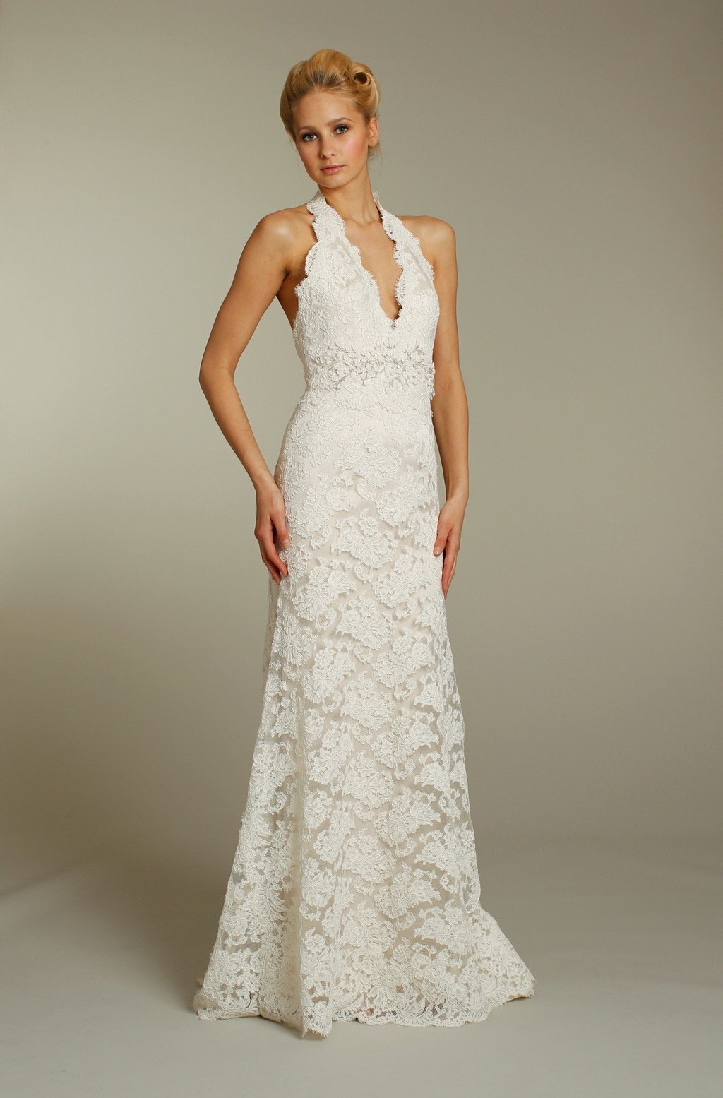 Ivory lace modified mermaid wedding dress with embellished