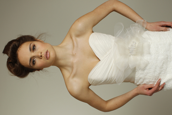 photo of Romantic ivory sweetheart neckline Fall 2011 wedding dress with bridal sash