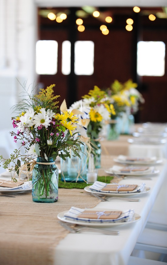 Rustic chic South Carolina wedding reception with wildflower centerpieces in mason jars
