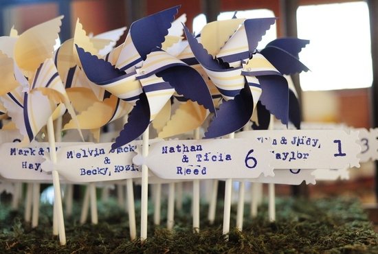 Navy and yellow pinwheel escort cards for rustic chic wedding reception