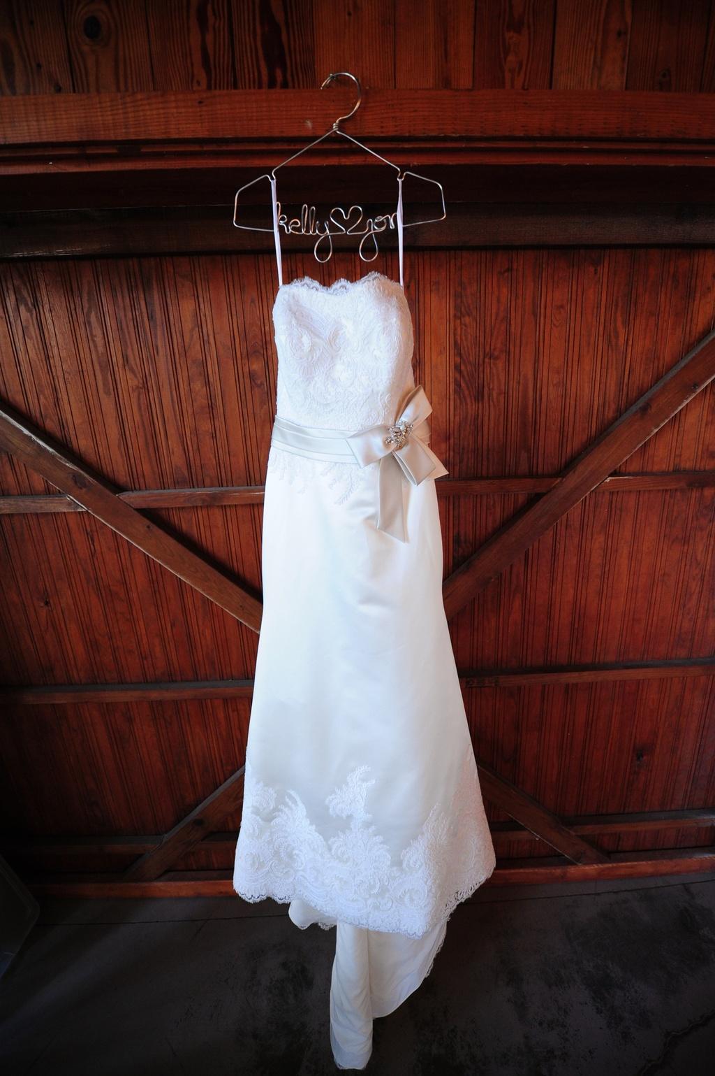 ivory lace strapless wedding dress hangs inside South Carolina ...