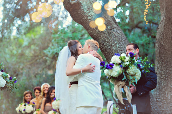 Real rustic wedding couple kiss at the ceremony