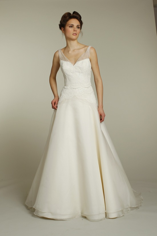 Classic ivory a-line wedding dress with lace applique and sheer illusion straps