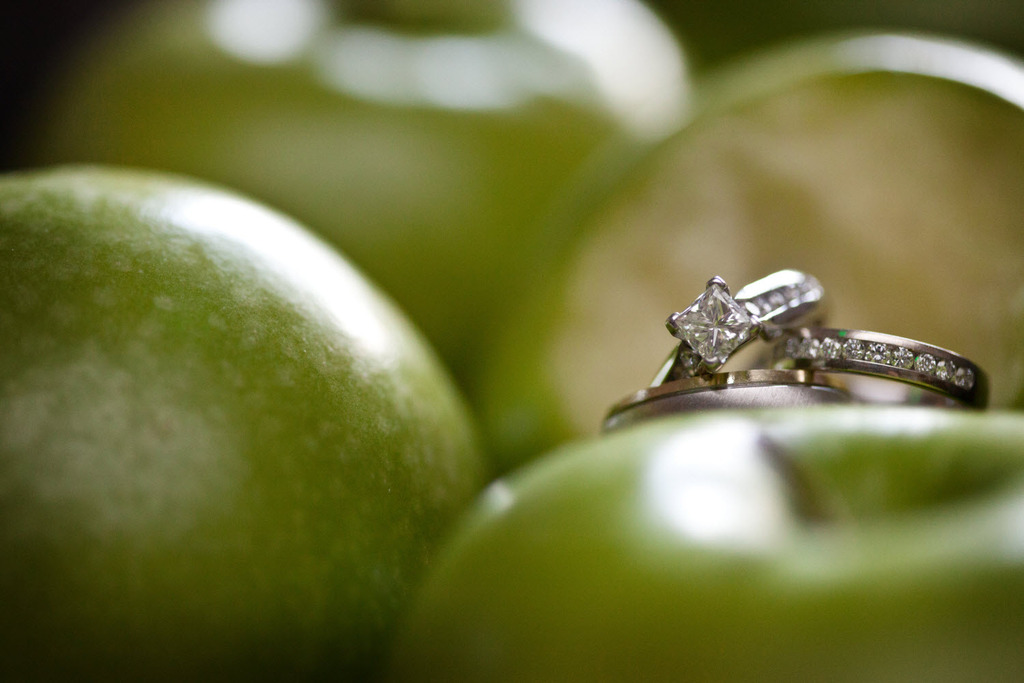 Apple-themed-florida-wedding-green-ivory-color-palette-diamond-engagement-ring.full
