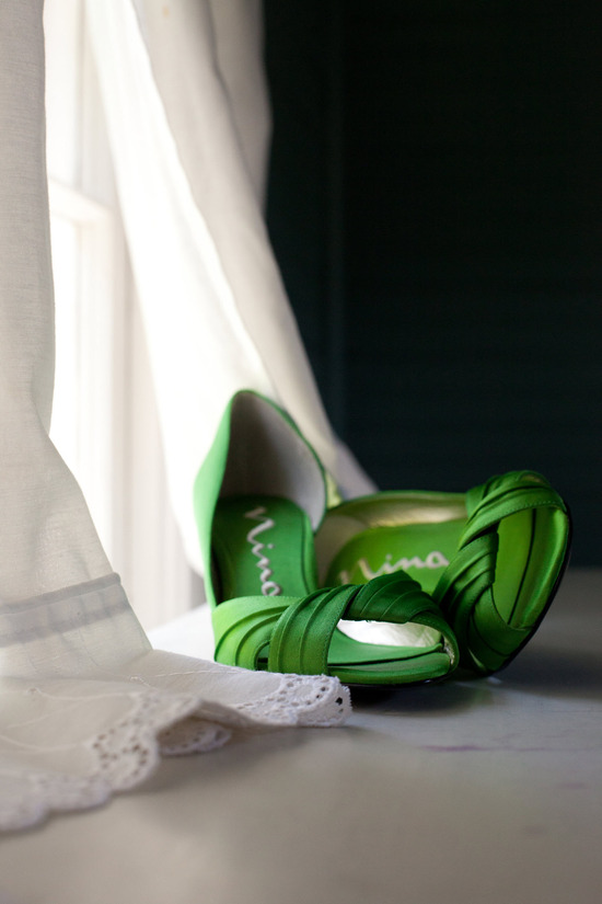 Chic green satin peep-toe bridal heels and ivory lace wedding dress
