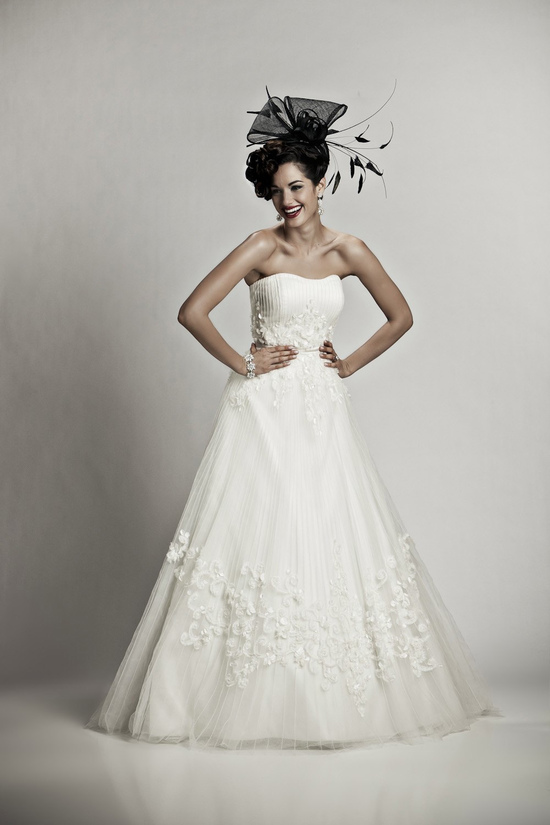 Classic ivory strapless ballgown wedding dress with lace and beading embellishment
