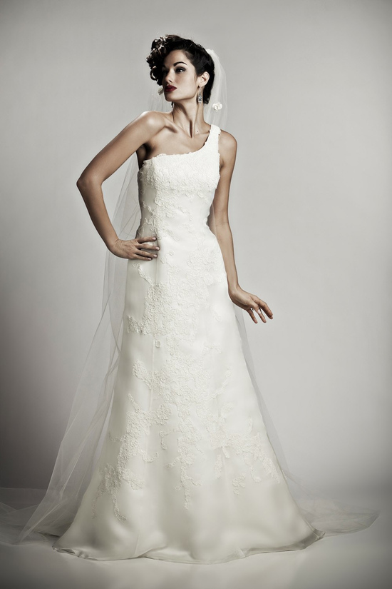 Romantic one-shoulder fit and flare ivory lace bridal gown