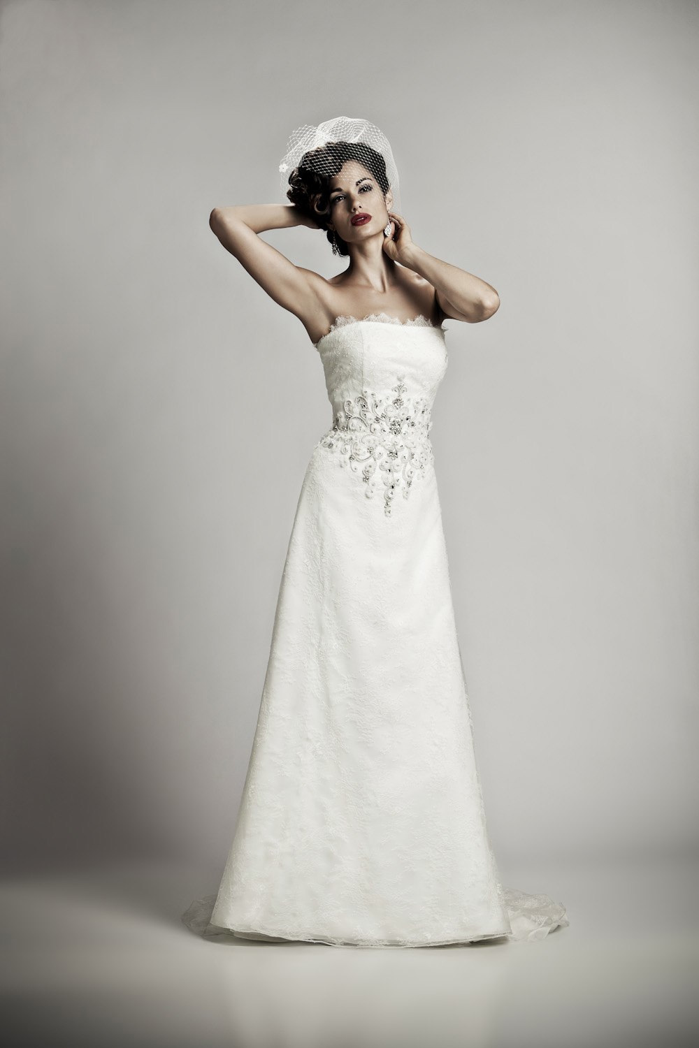 Classic white modified a-line strapless bridal gown with beading ...