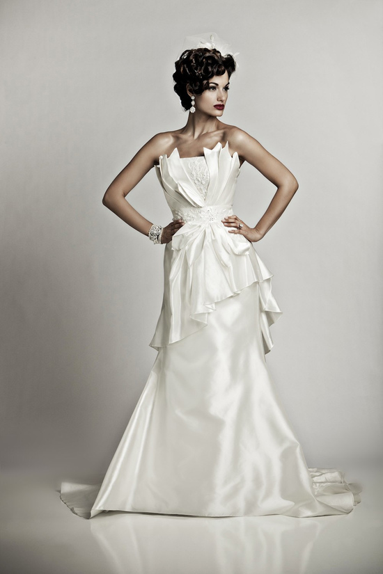 Glamourous ivory silk strapless mermaid wedding dress with pleating details