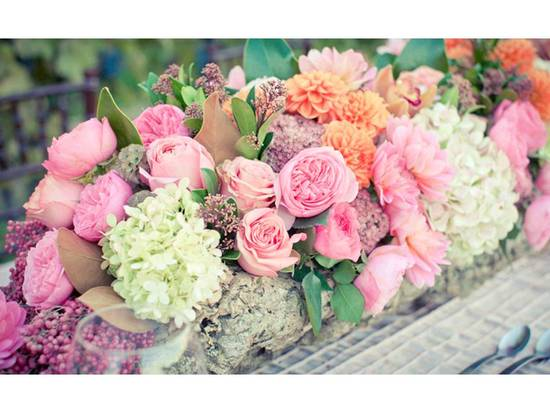 Pink peonies, ivory queen anne's lace and coral rananculus in romantic wedding centerpieces