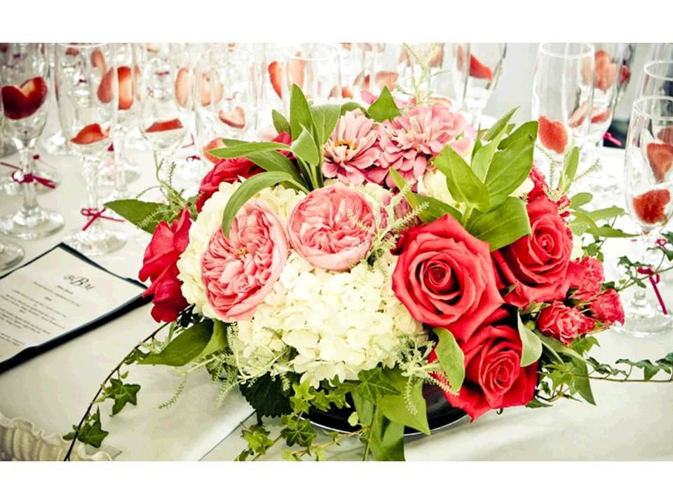 Romantic coral, pink, ivory and sage wedding flower centerpieces