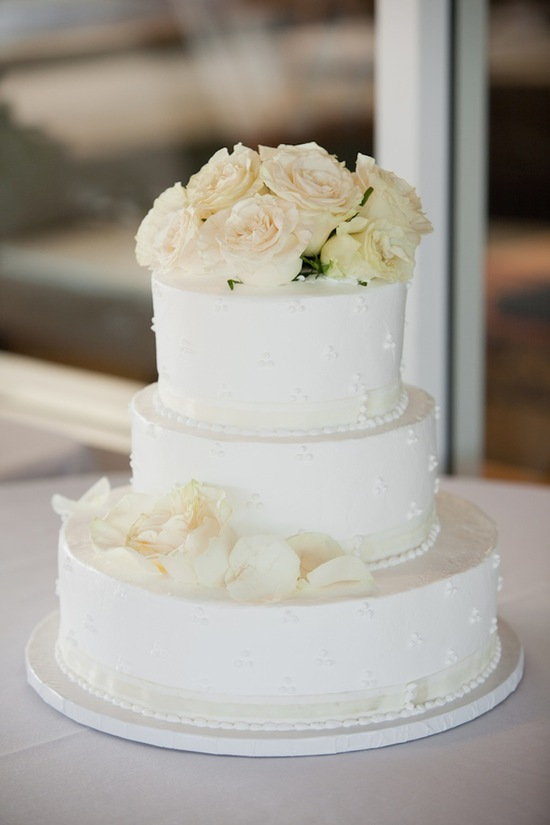 Classic white wedding cake with roses