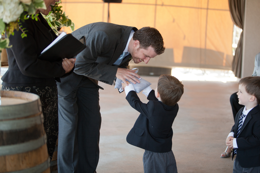 Groom gets rings from twin ring bearers