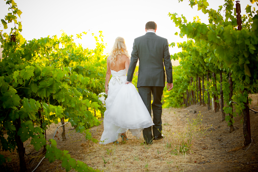Real_bride_and_groom_walk_in_the_vineyard.full