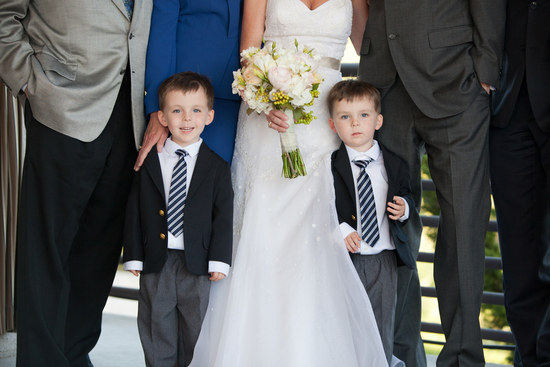 Twin ring bearers pose with bridal party