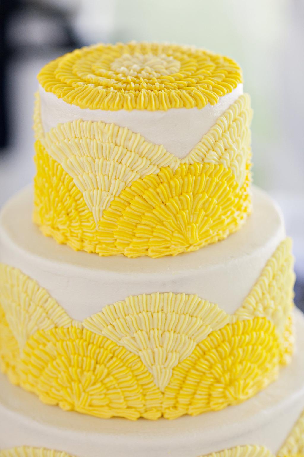 Bright yellow and white classic wedding cake