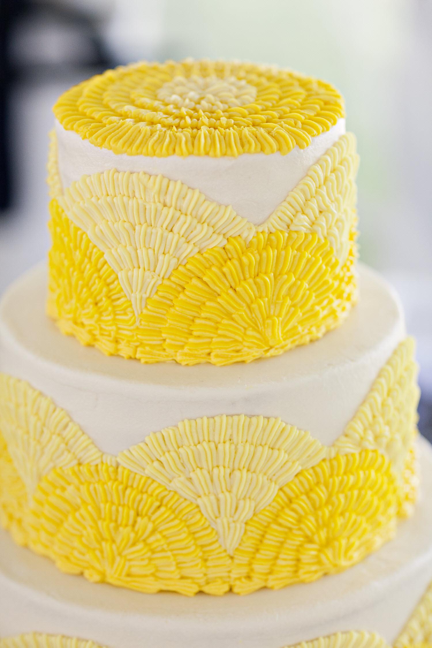 Bright yellow and white classic wedding cake | OneWed.com
