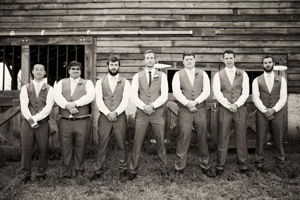 Black-and-white-wedding-photography-real-weddings-outdoor-venue-groom-groomsmen.full