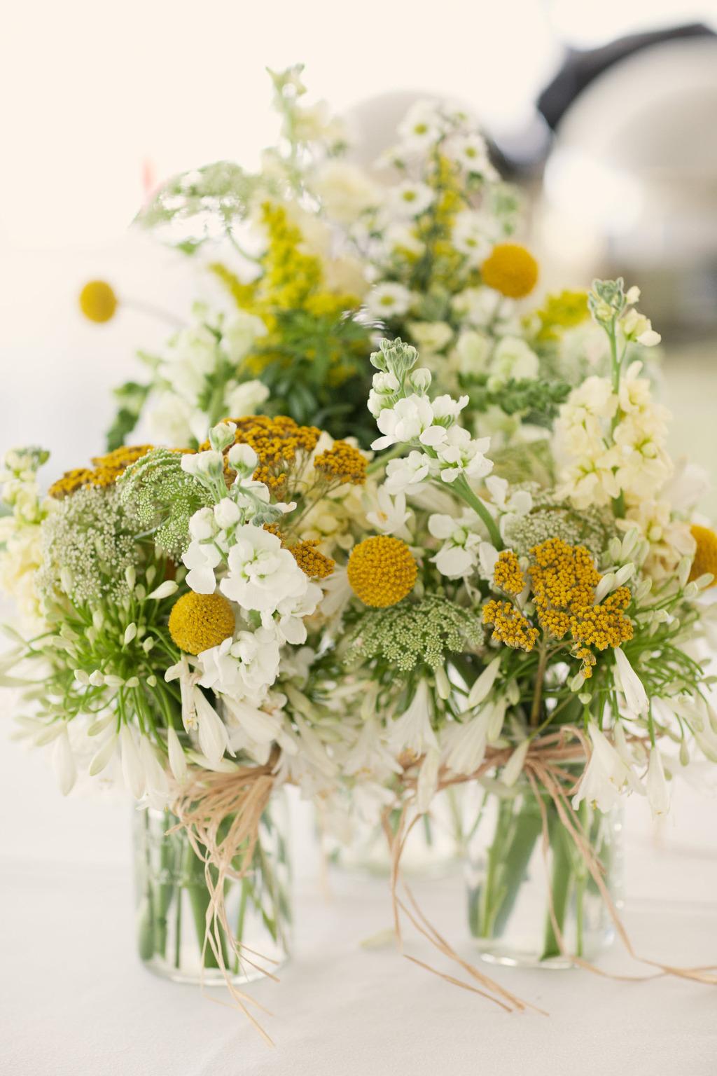 Outdoor-spring-wedding-yellow-white-wedding-flower-centerpieces.full