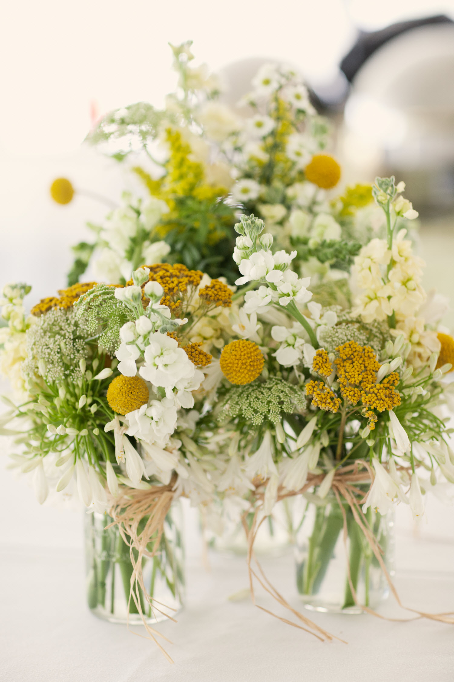 Whimsical spring wedding flowers and wedding reception for Floral arrangements for wedding reception centerpieces