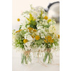 Outdoor-spring-wedding-yellow-white-wedding-flower-centerpieces.square
