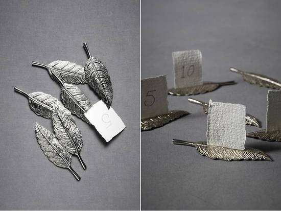 Vintage-inspired silver escort card holders for wedding reception by BHLDN