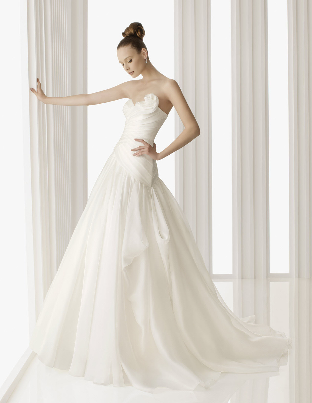 Classic ivory silk a-line Rosa Clara wedding dress with rosette detail at the neckline