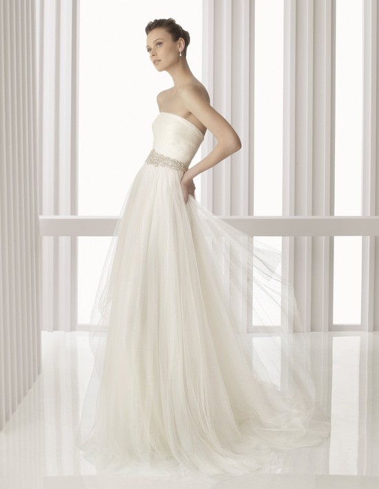Ethereal strapless ivory Rosa Clara wedding dress with sheer tulle overlay and beaded bridal belt