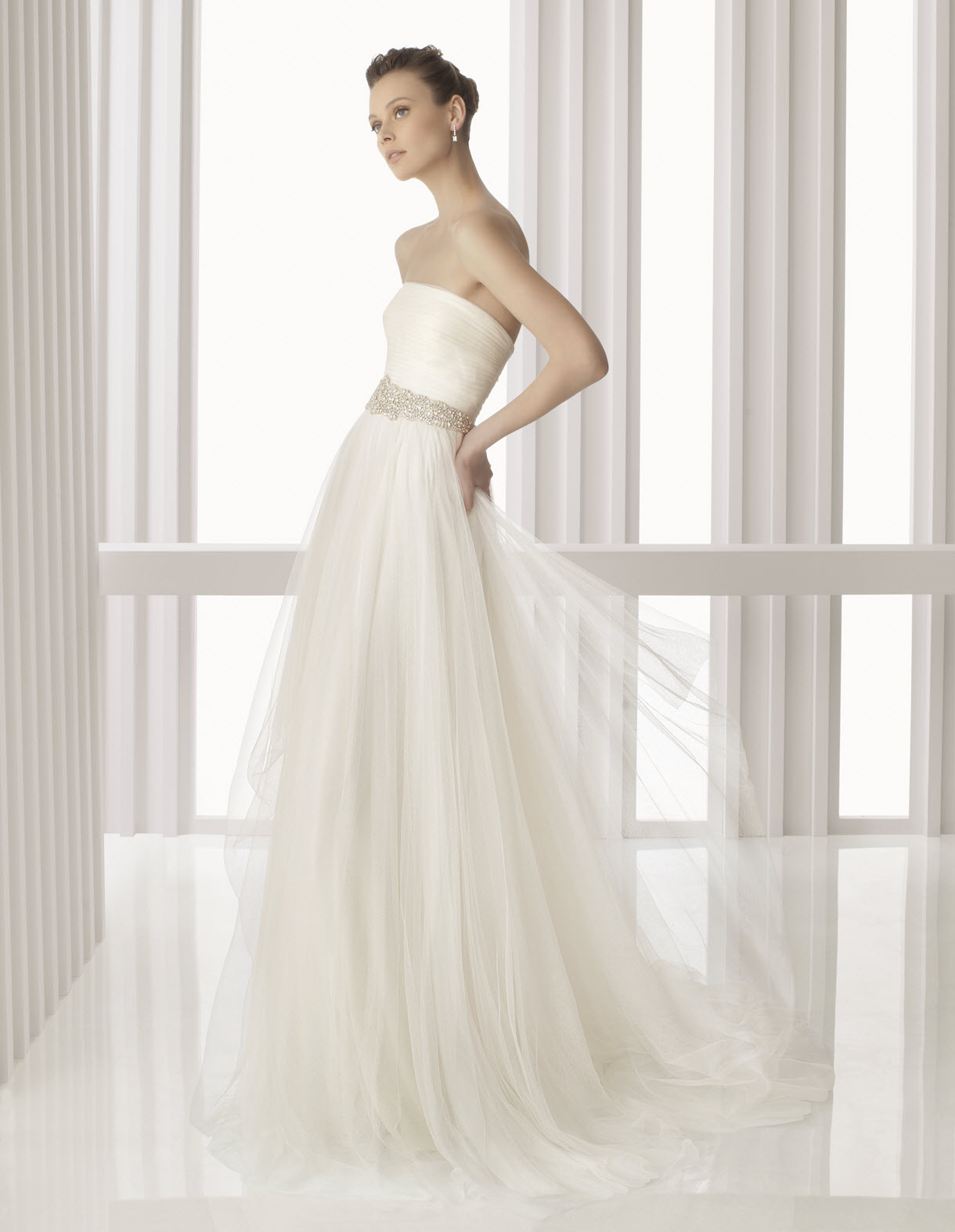 ethereal strapless ivory rosa clara wedding dress with