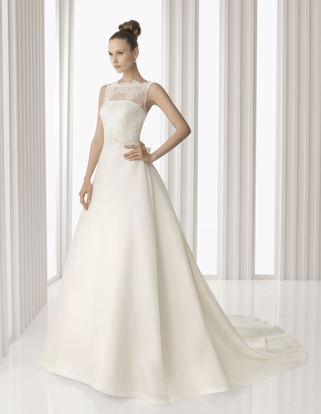 Classic ivory a line Rosa Clara wedding dress with sheer