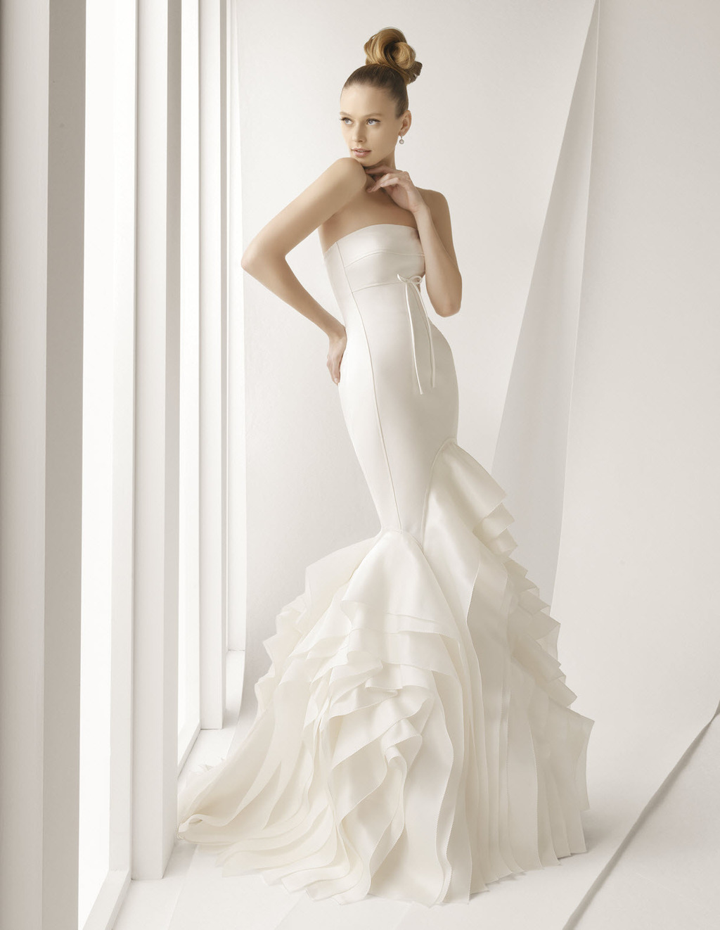 Stunning ivory strapless mermaid wedding dress with textured skirt and dainty bow