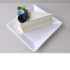 White-wedding-cake-blue-green-spring-wedding-flowers-guest-favor-boxes.square