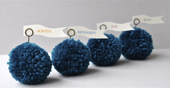 Adorable wedding reception escort card holders- turquoise blue pom poms