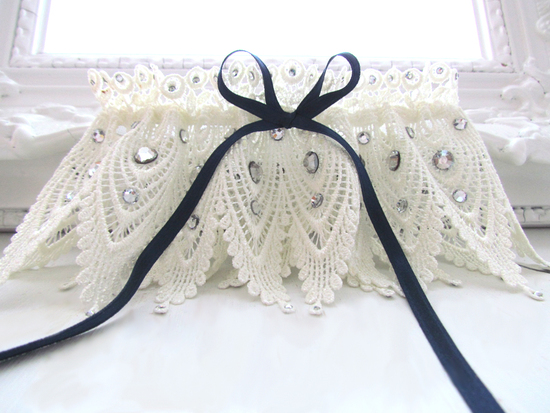 Vintage-chic ivory lace bridal garter with something blue navy satin ribbon and rhinestone details