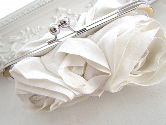 Chic ivory silk handmade bridal clutch with romantic floral embellishments