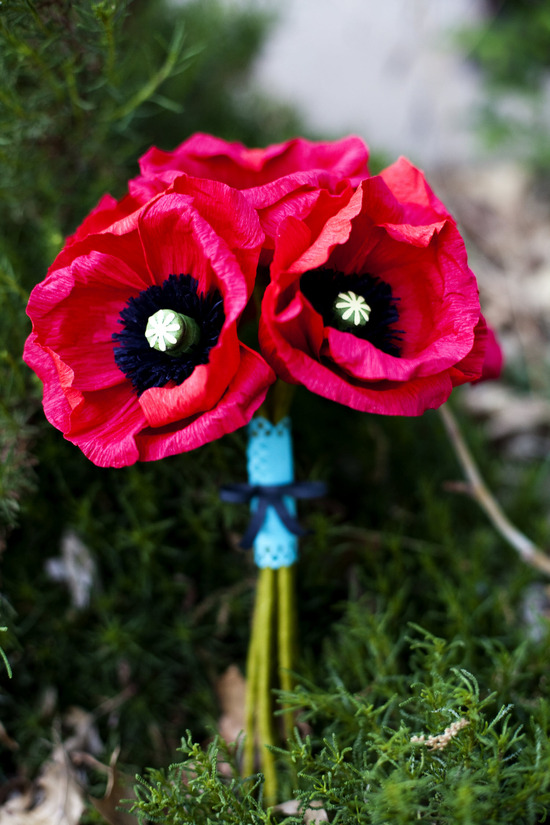 Bright red and black poppy bridal bouquet made from handmade paper wedding flowers