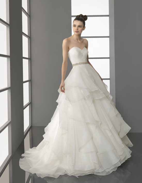 Sweetheart neckline Aire Barcelona bridal gown with whimsical tiered skirt and dazzling bridal belt