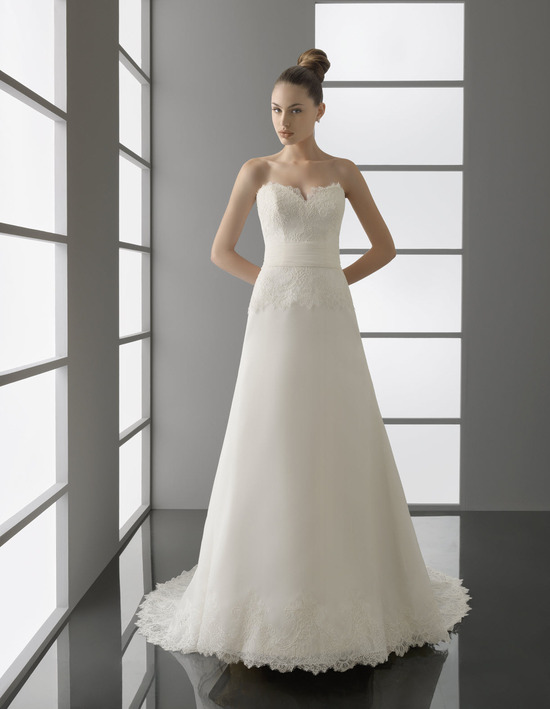 Romantic ivory lace strapless modified a-line wedding dress with notched strapless neckline