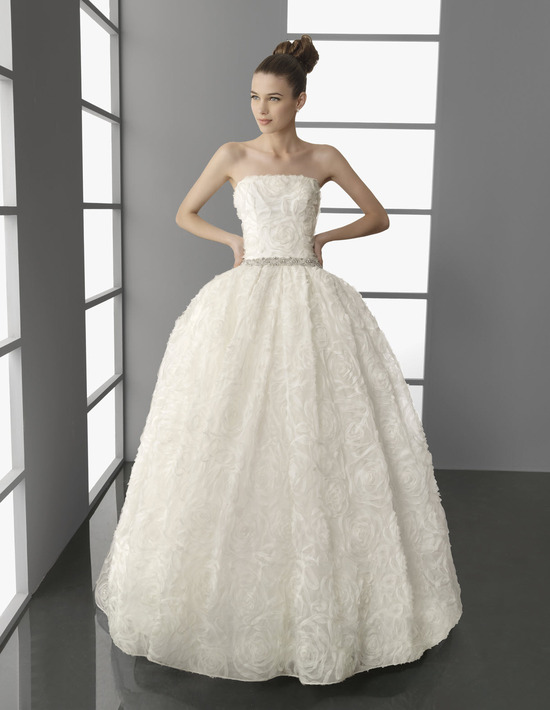 Elegant ivory strapless wedding dress with princess silhouette and beaded bridal belt