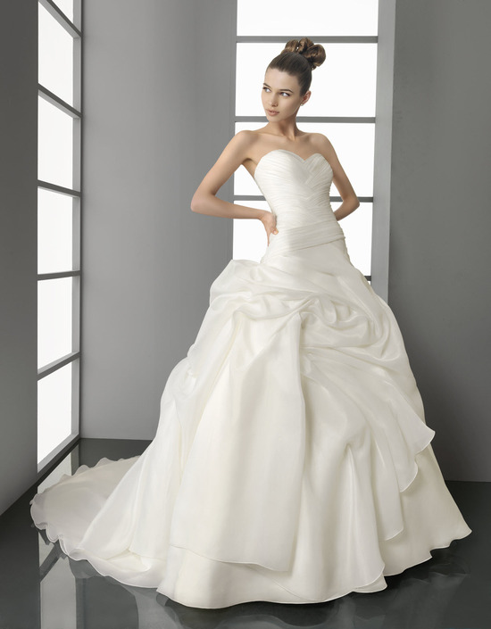 White silk Spring 2012 Aire Barcelona wedding dress with modern bustle detail on ball gown skirt