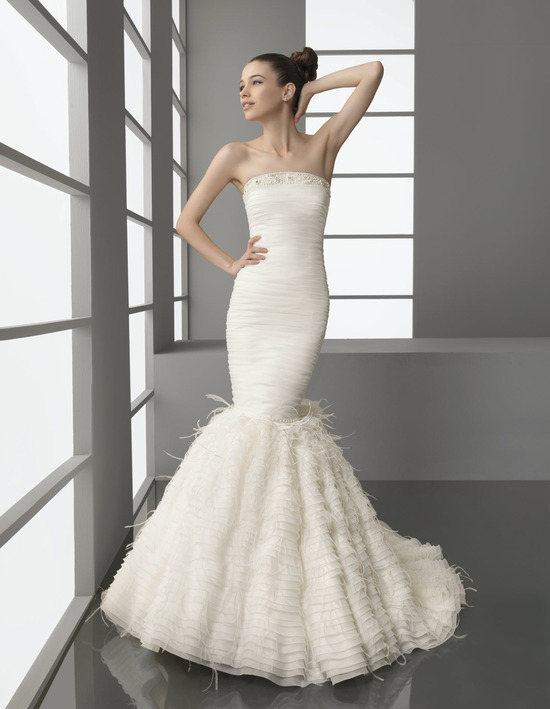 Strapless drop waist mermaid wedding dress with feather-adorned trumpet skirt