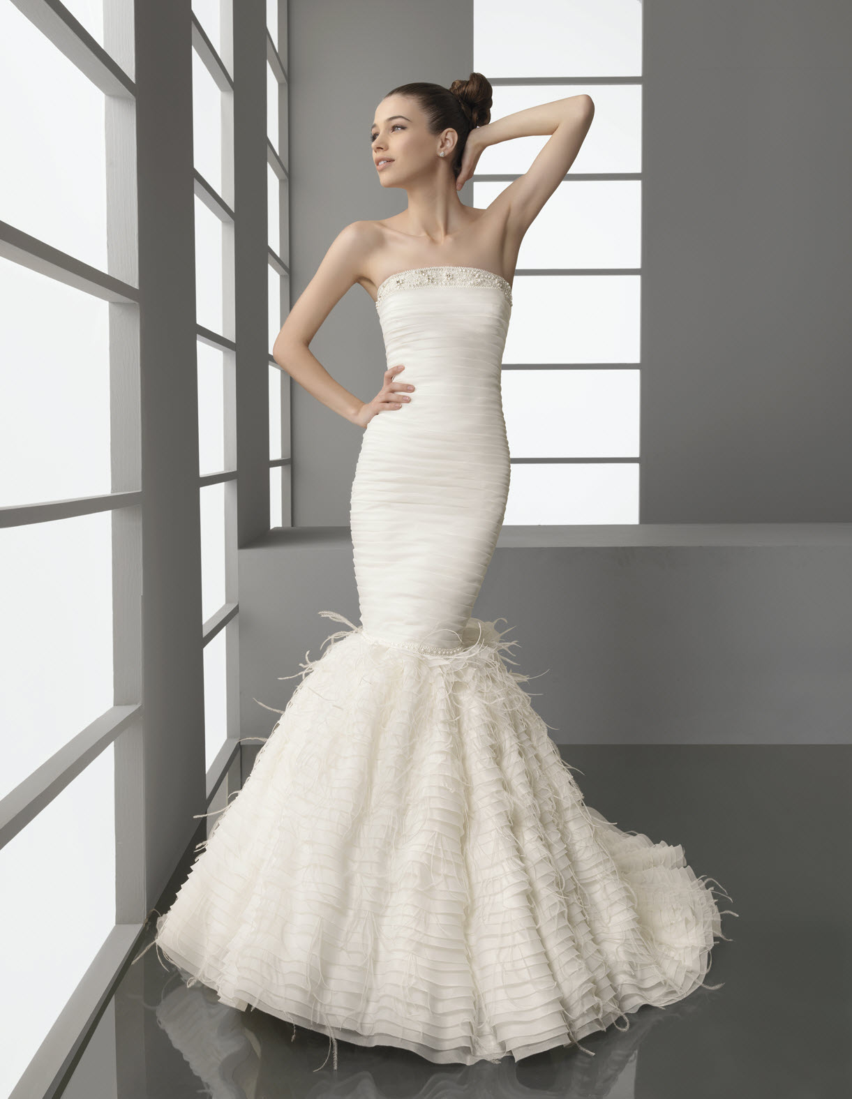 Strapless drop waist mermaid wedding dress with feather