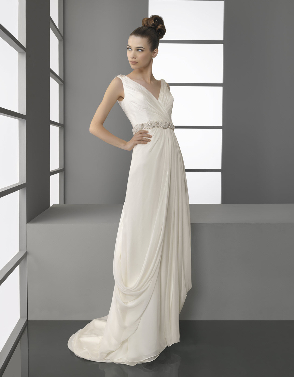 Chic ivory v-neck draped bridal gown by Aire Barcelona with beaded bridal belt