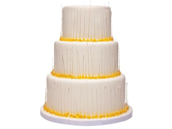 3-tier ivory wedding cake with golden yellow dewdrops design