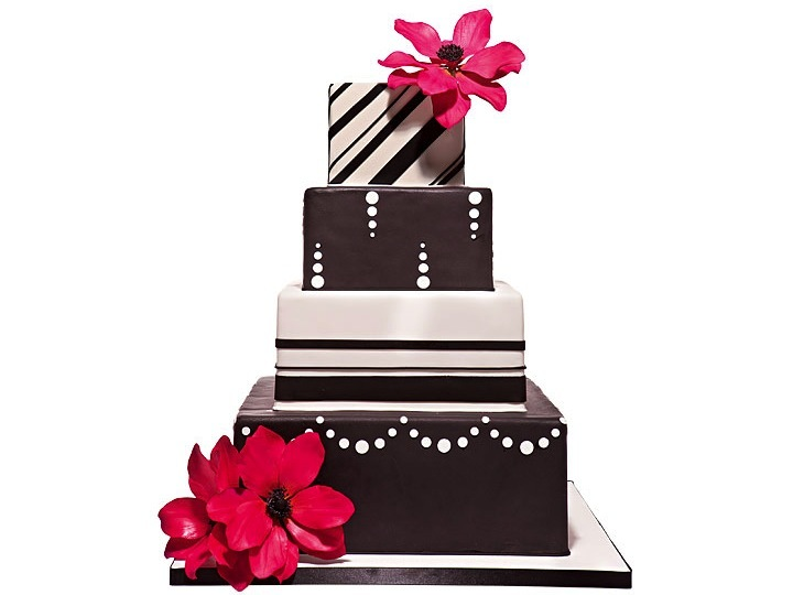 Modern 4-tier square stacked wedding cake with hot pink flowers