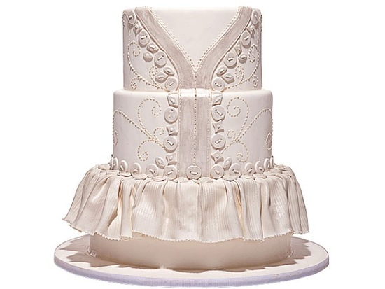 Pearl and ivory elegant wedding cake with covered button design